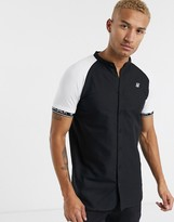 SikSilk short sleeve shirt in black with contrast sleeves