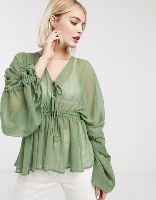 Asos DESIGN sheer top with ruched volume and tie detail