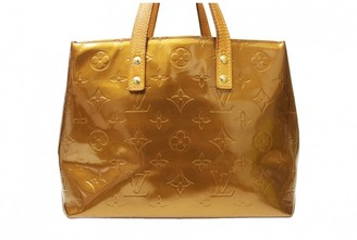 Louis Vuitton Reade Gold Patent leather Handbags