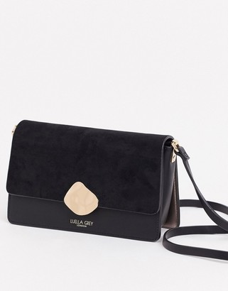 Luella Grey cross body bag in black with contrast suede front flap and molten gold buckle