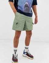 Asos Design DESIGN cargo shorts with utility pockets in green