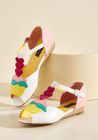 IHW005901 Put a 'merry' on top of an already sweet day by stepping into these white wedges. Boasting cupcakes, layered hearts, and topstitched accents in hues of magenta, pastel pink, aqua, and yellow, these vegan faux-leather peep toes are a stylish tr