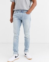 Hollister distressed skinny jeans in light destroyed wash