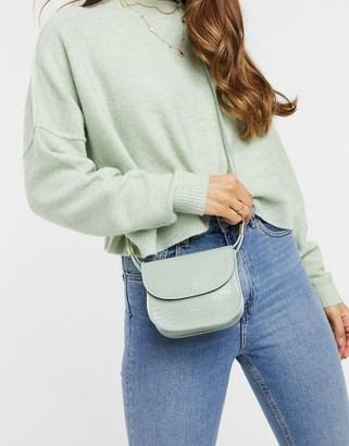 ASOS DESIGN cross body saddle bag in green croc