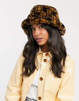 Exact Product: Design DESIGN monogram faux fur bucket hat, Brand: Asos, Available on: shopstyle.com, Price: $22