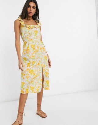 ASOS DESIGN cotton midi sundress with shirred waist and lace up back in floral print