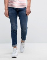 Love Moschino Love MoschinoMuscle Fit Jeans With Peace Badge In Slim Fit