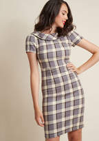 AFA3499 You had an inkling that vintage-inspired fashion would never go out of style, which is why you continue to invest your interests in frocks like this collared sheath dress! With short sleeves, a black, ivory, and grey plaid pattern, and the perfect wiggle