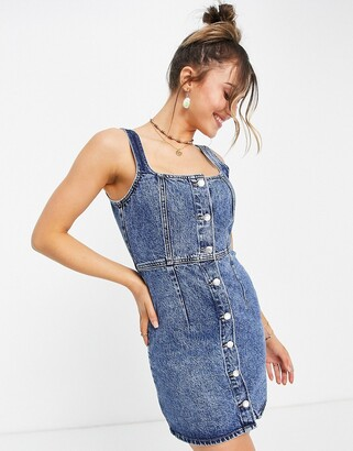 Monki Moa organic cotton button through denim mini dress in mid wash blue