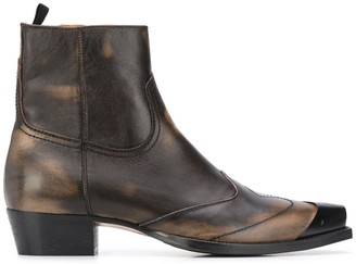 Represent distressed Western boots