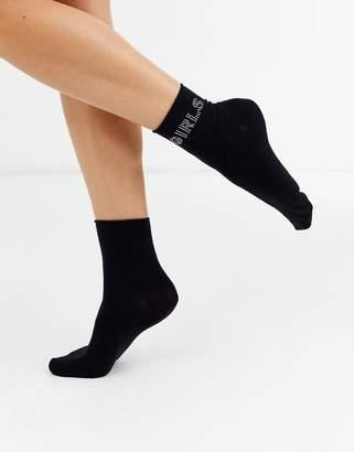 Monki socks with GIRLS slogan in black
