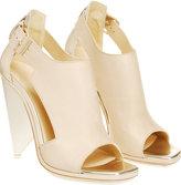 Cone heel sling backs