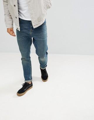 ASOS DESIGN tapered jeans in vintage dark wash