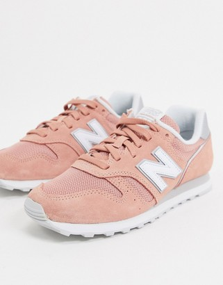 New Balance 373 sneakers in coral
