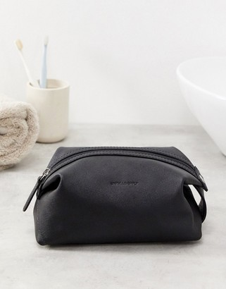 ASOS DESIGN leather washbag with emboss in black saffiano