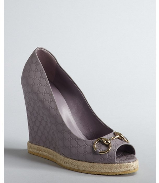 Gucci wisteria double G embossed leather and jute wedges
