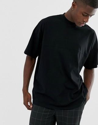 Asos DESIGN oversized jersey turtleneck with seam detail in black