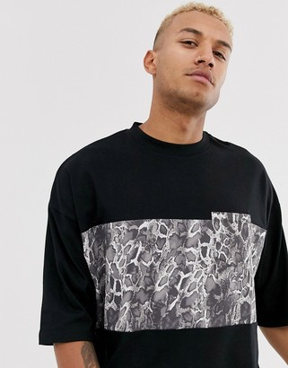 ASOS DESIGN organic cotton oversized t-shirt with animal color block block and contrast pocket