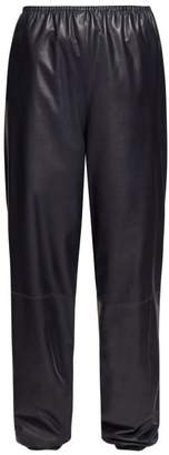 The Row Dez Gathered Waist Leather Trousers - Womens - Navy