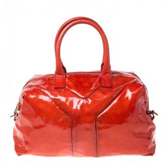 Saint Laurent Easy Orange Patent leather Handbags