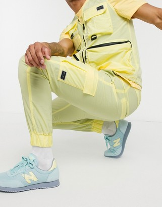 Criminal Damage nylon utility jogger co-ord in yellow