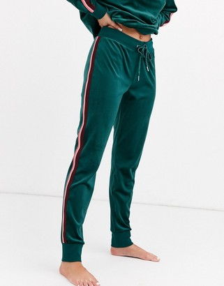 Hunkemoller velour jogging bottoms with taping in green