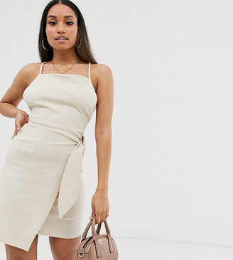 Asos DESIGN Petite strappy back wrap mini dress with tortoise shell buckle-Cream