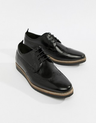ASOS DESIGN brogue shoes in black leather with wedge sole