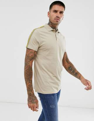 Asos Design DESIGN organic polo shirt with contrast taping in beige-Gray
