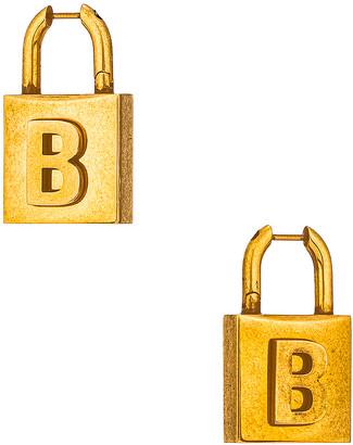 Balenciaga Lock Earrings in Antique Gold | FWRD
