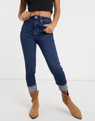 Free People Raw high-rise skinny jeans in blue