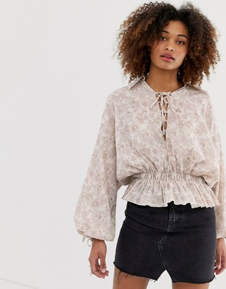 Asos DESIGN long sleeve puff sleeve top with lace up detail in paisley print