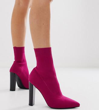 Asos DESIGN Wide Fit Enhance block heel sock boots in magenta
