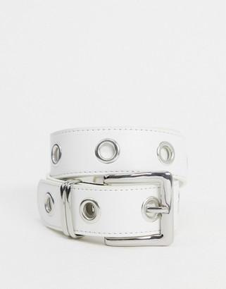 ASOS DESIGN eyelet jeans waist and hip belt in white