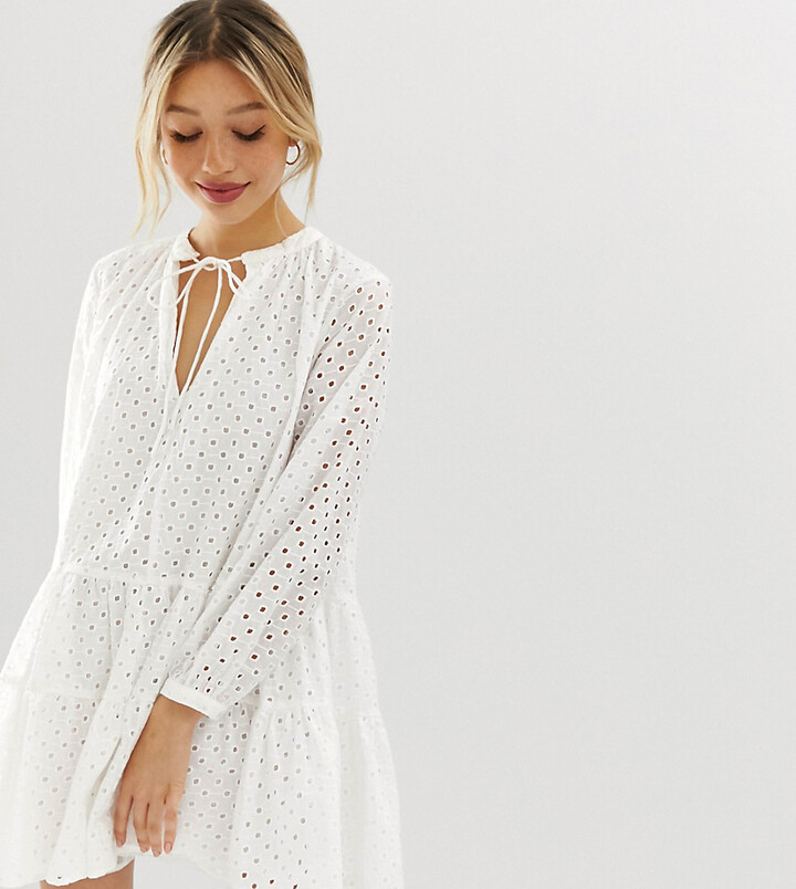 ASOS DESIGN Petite tiered trapeze mini dress in broderie in white
