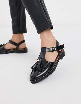 Asos DESIGN Moving leather tassel flat shoes in black