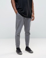 Asos Tapered Joggers With Pockets In Gray