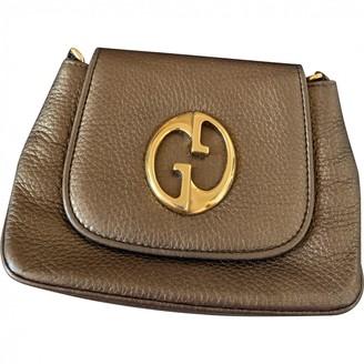 Gucci 1973 Metallic Leather Clutch bags