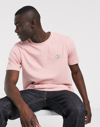 Nudie Jeans Uno badge logo t-shirt in rose pink