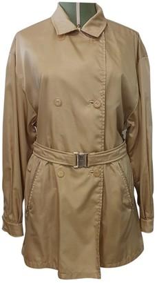 Prada Beige Synthetic Trench coats