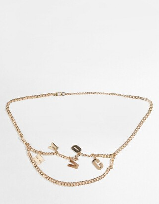 ASOS DESIGN metal chain belt with 'havoc' in gold