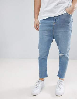 Asos Design Drop Crotch Jeans In Light Wash Blue With Rips