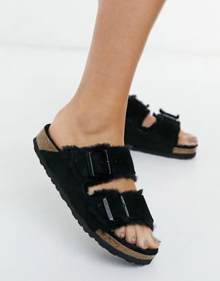 Birkenstock Arizona flat sandals in black with fur lining