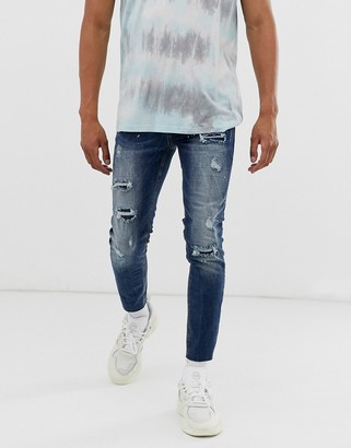 Sixth June skinny jeans in mid blue with distressing