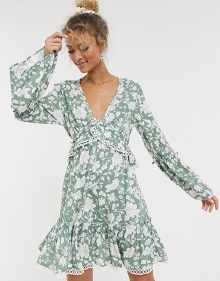 ASOS DESIGN fluted sleeve open back skater mini dress with lace inserts in floral print