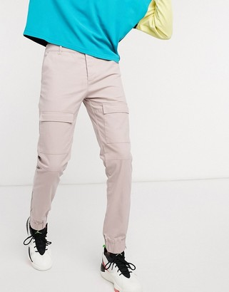 ASOS DESIGN cargo pants in slim fit with ankle zips in pink