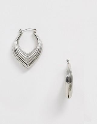 Sacred Hawk abstract hoop earrings in silver