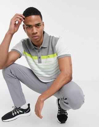 Calvin Klein Golf Flint polo shirt in white with green stripes
