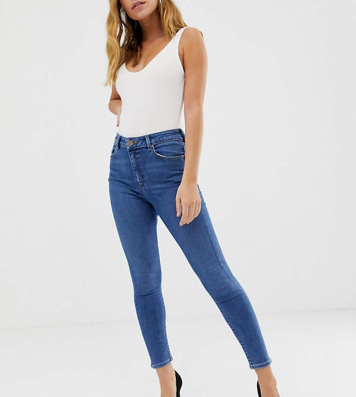 Asos DESIGN Petite Ridley high waisted skinny jeans in mid wash blue