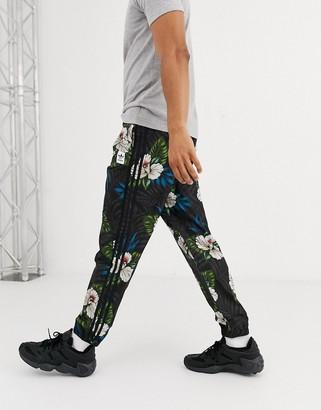 adidas Skateboarding Skateboarding 3 stripe joggers with floral print-Multi